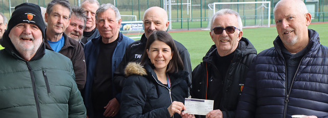 Pictured, Lianne Morse receives the cheque from Martin Coles, secretary of KTWFC.