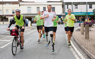 Paralympian visits town as he runs length of Britain