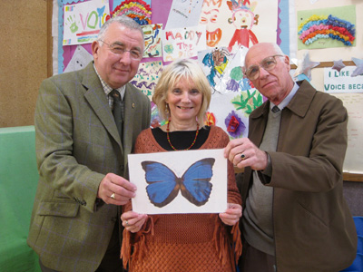 Trisha Williams with Cllr Alan Hale, left, and volunteer and church hall member Les Herbert